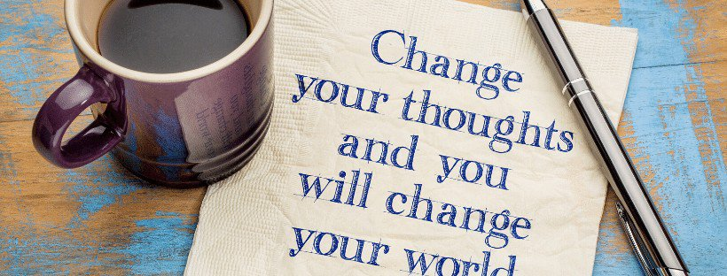 change your thoughts and you will change your world on napkin with pen and coffee cup