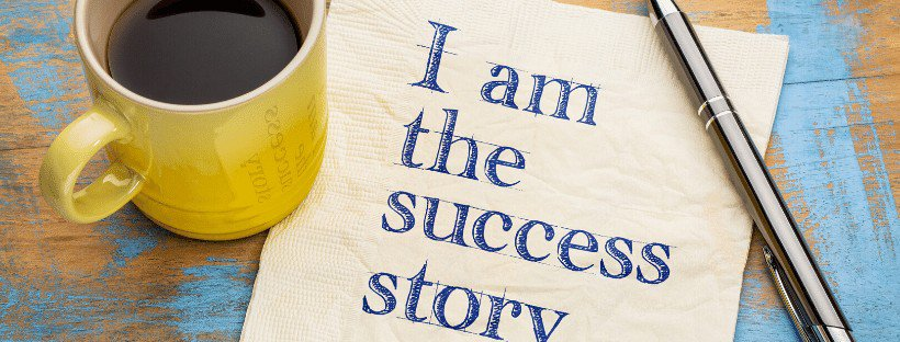 i am the success story on napkin with pen and yellow coffee cup