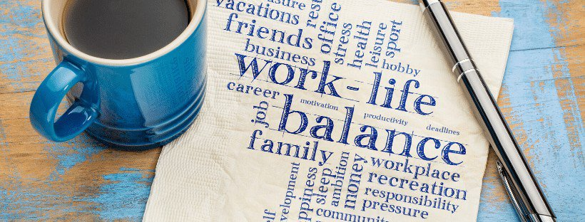 work life balance on napkin nest to pen and blue coffee cup
