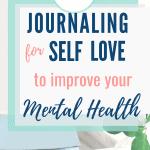 journaling for self love pages inside light blue journal laying in wooden box